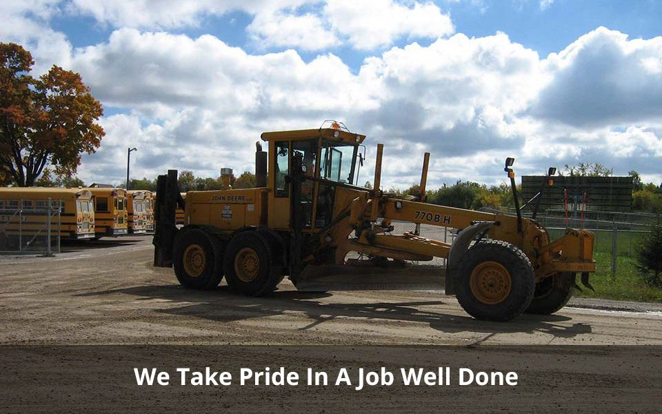 We Take Pride In A Job Well Done | road grader
